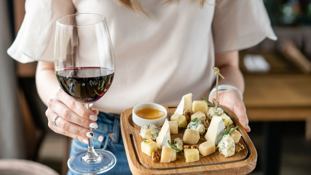 woman with wine and cheese