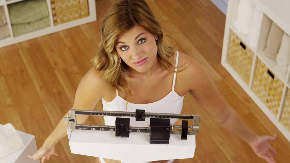 woman frustrated with scale