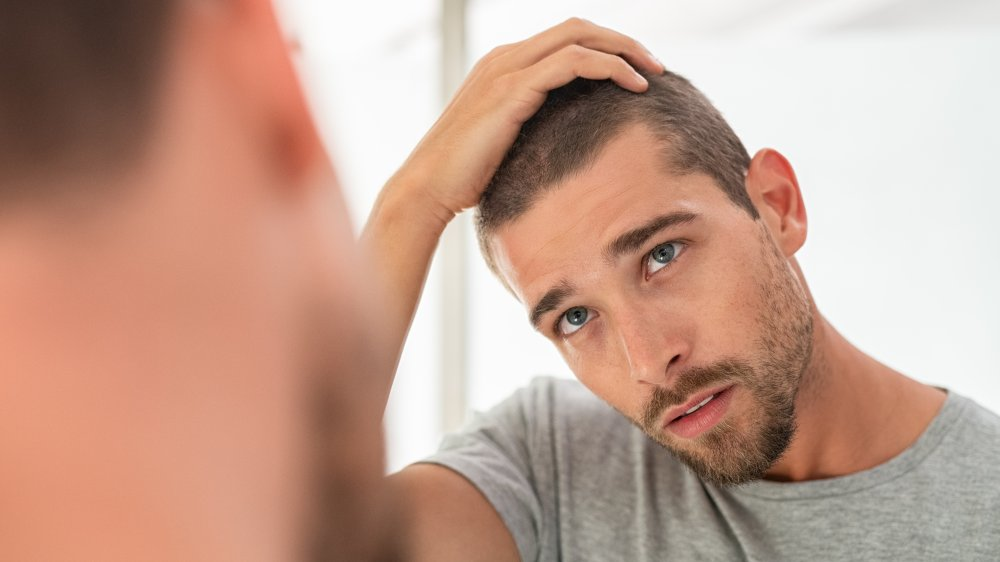 man worried about hair loss