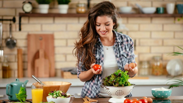 Woman cooking healthy food in a modern kitchen