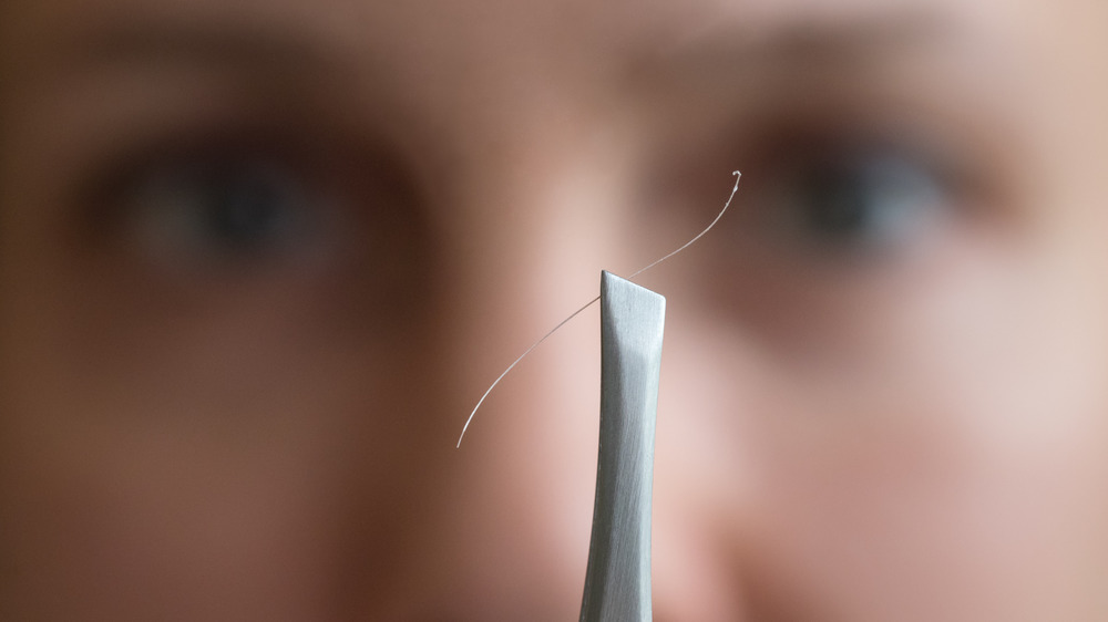 Think Twice Before Plucking Your Gray Hair. Here's Why.