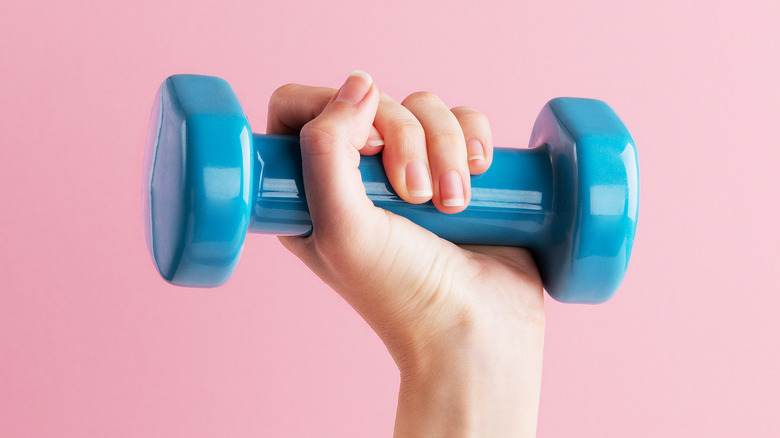 hand holding small dumbbell